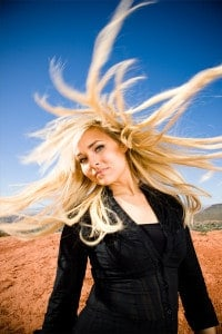 Portrait photo of a woman with her hair twirling around--fun!
