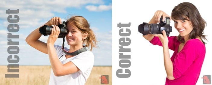 Two models holding cameras--one correctly, and the other one holding it the wrong way.