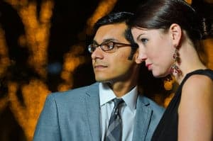 Portrait of a business man and a woman in business attire at night in the city.