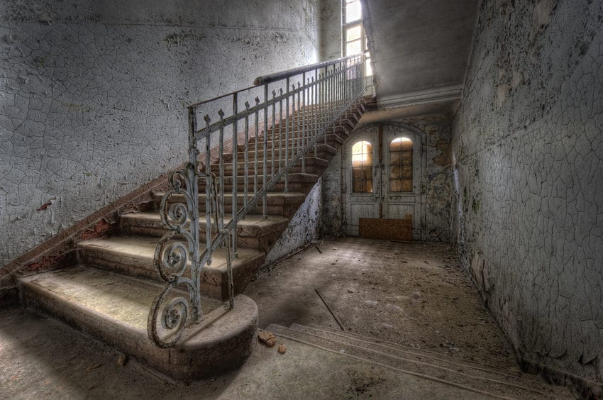 HDR photo of a staircase in a gritty and textured room.