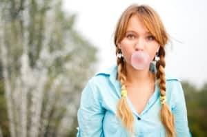 A young woman gets a portrait photo tip when using bubblegum as a prop.