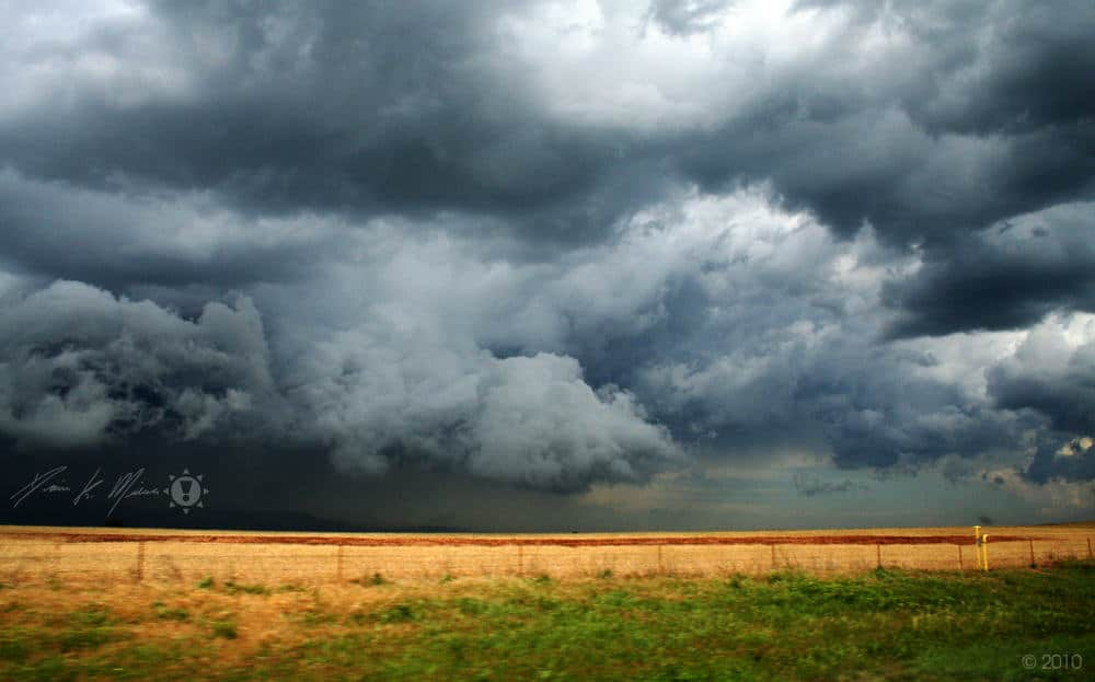 Photo of a spring thunder storm moving across a farm.