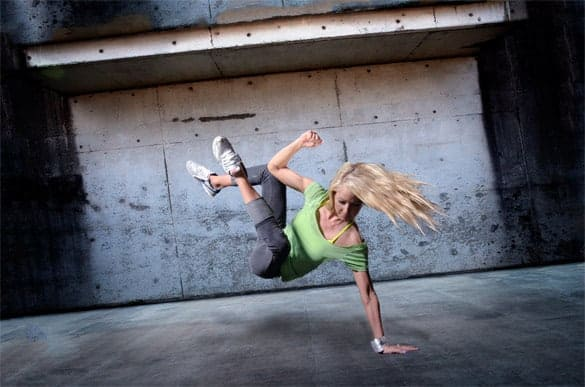 Woman Break Dancing in a Grungy Concrete Room