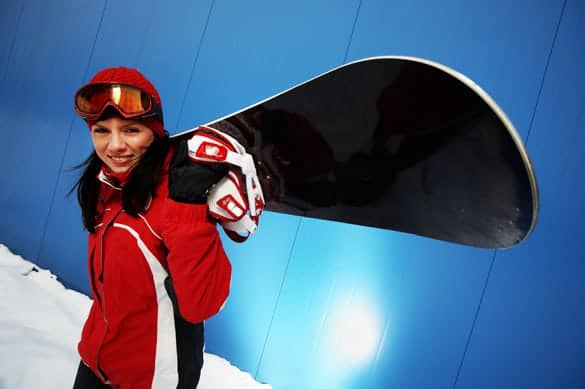 Portrait of a girl with a snowboard