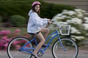 A girl gets her photo taken on her new bike