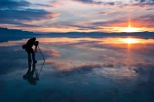 Photographer learning the craft as he shoots a sunrise