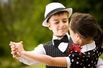 Two kids dancing at a wedding