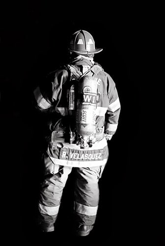 Second place winner - Kati Toy.  This photo was taken during a night fire that Kati witnessed.  The firefighter is being illuminated by headlights from a vehicle.  The firefighter didn't know the photo was taken.
