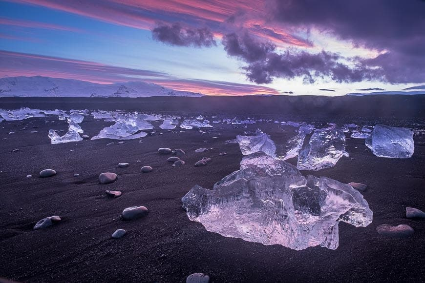 I photographed these huge chunks of ice along the black sand beaches at Jokulsarlon. The sunset really lit up the ice to make for a dynamic scene.