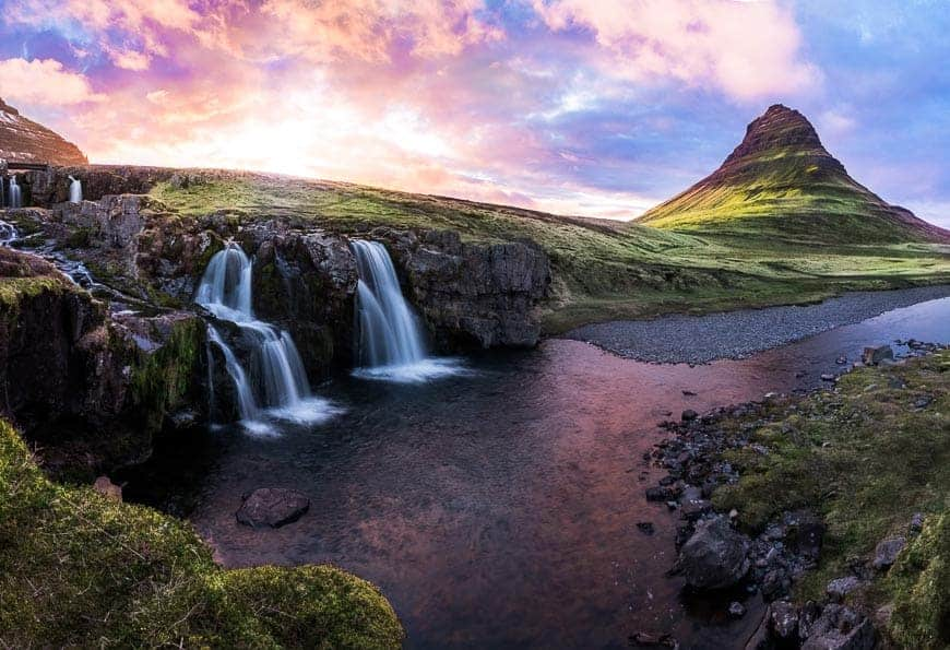 I shot this picture in Iceland. It was a gorgeous sunset, but one thing that helped me to make the color look dynamic is that I shot very wide to include some of the blue sky on the sides of the colorful areas.