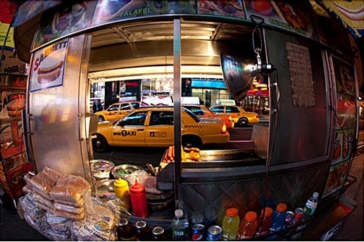Photography tip of shooting into a busy city street with a fisheye lens.