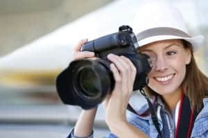 Photographer capturing photo with professional camera