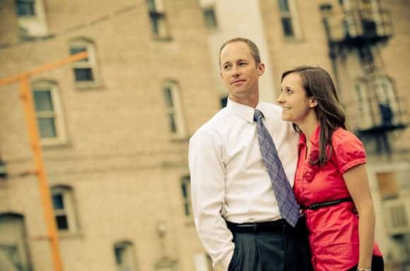 Engagement photo of a couple in a city setting.