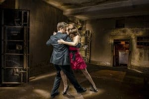 Dancing couple in a basement