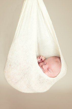 Newborn baby sleeping in a hammock