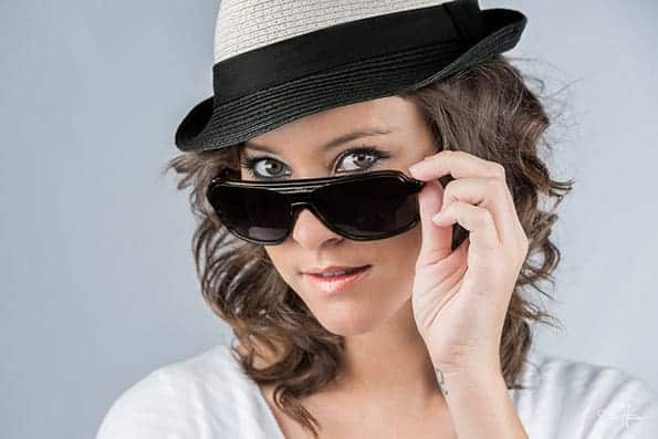 Model with fedora and sunglasses.