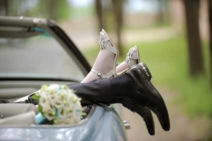 Newlyweds' Legs in a Car