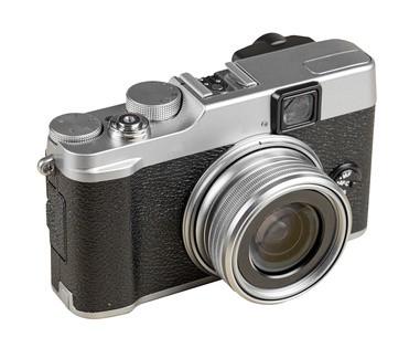 Vintage rangefinder style camera isolated on white