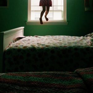 Anna Shirley jumping on the bed