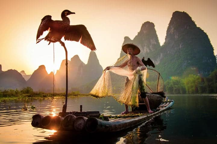Photo of a traditional cormorant fisherman by Jim Harmer.