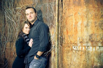 The rule of thirds gives balance to this composition of a couple in front of a wall in Meridian Idaho.