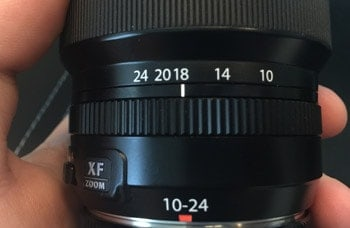 The focal length scale shows that this lens can go as wide as 10mm and as long as 24mm (zoomed in). Right now, it is set at 18mm.