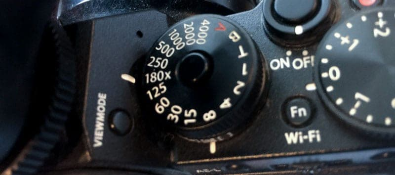 "The small ""x"" next to the 180 on the shutter speed dial on the Fuji XT1 denotes that it is the max flash sync speed."