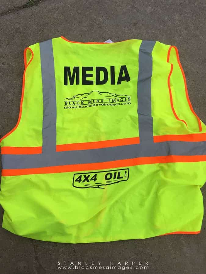At most motorsports events, there will be a sea of yellow safety vests such as this one
