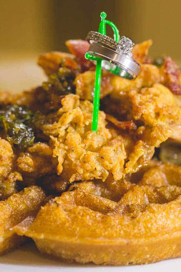 Erica Kay Photography - A photo of rings on a plate of chicken + waffles