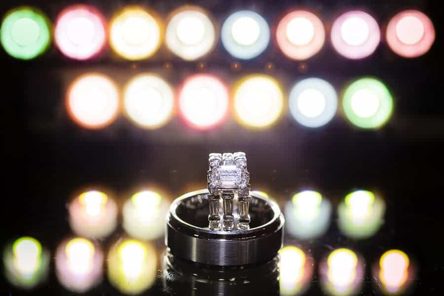 Ring Shots: A photo of rings on a mirror with two rows of colored lights behind them.