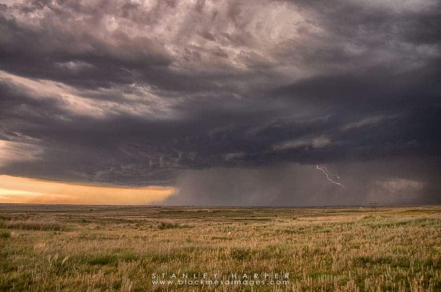 A growing thunderstorm rolls over the Oklahoma Panhandle Landscape