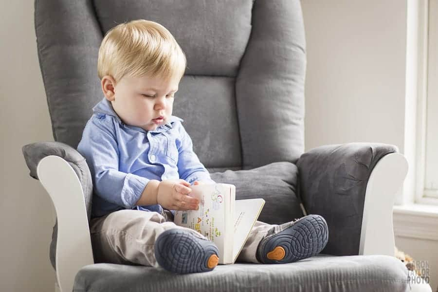 This photo was taken in this little guy's bedroom. He's reading one of his favorite books in the chair he and his parents read in each day.