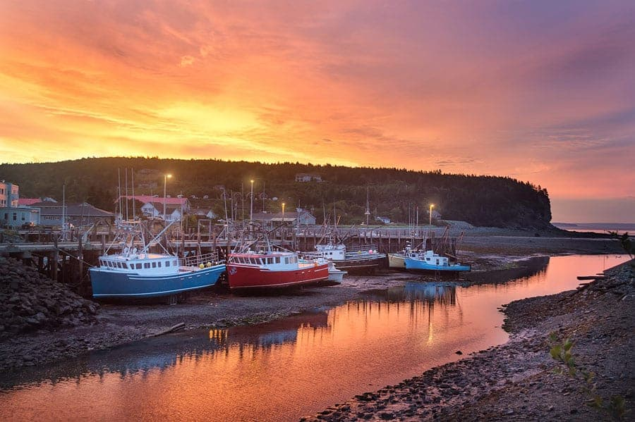 A photo of grounded fishing boats during low tide at sunrise in Alma, just outside of Fundy National Park, NB.