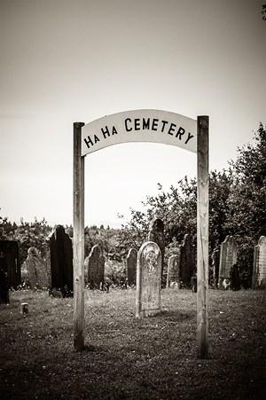 A sepia toned photo of the Ha Ha Cemetery in New Brunswick.