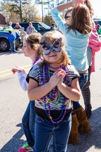 This girl in a Mardi Gras mask was too cute to not photograph