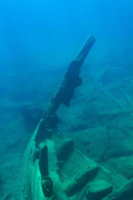 An underwater photo of a shipwreck in Tobermory, Ontario.