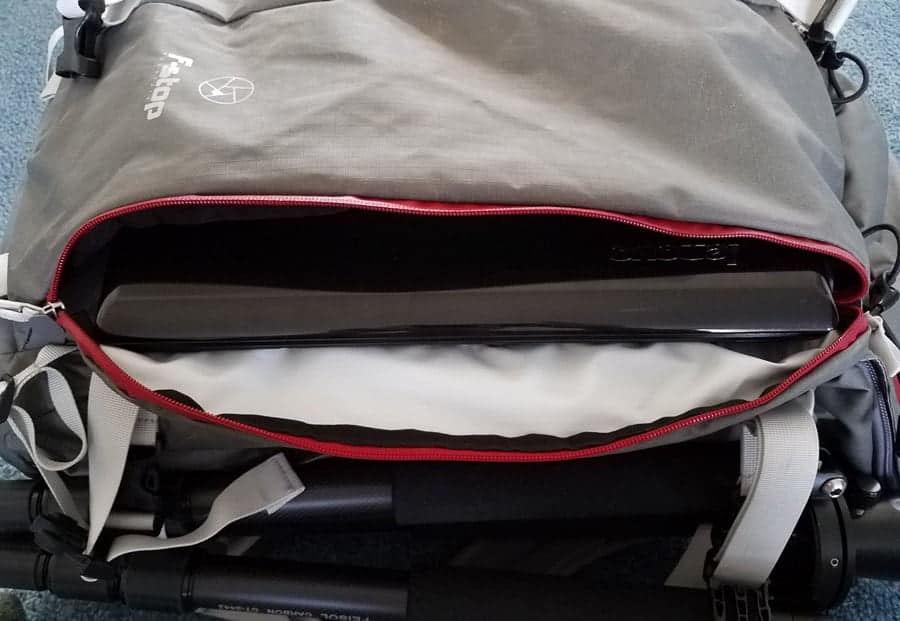14-inch laptop in the front pouch of the Ajna.
