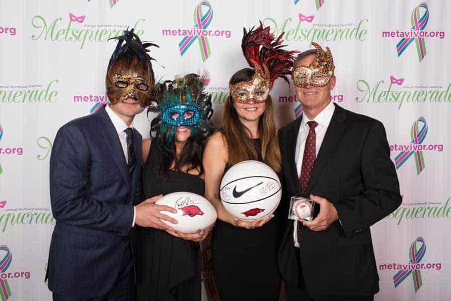 guests with masks and prizes at charity event