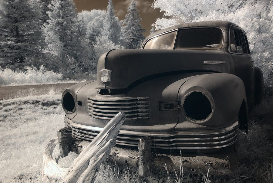 An infrared photo of a rusted truck.