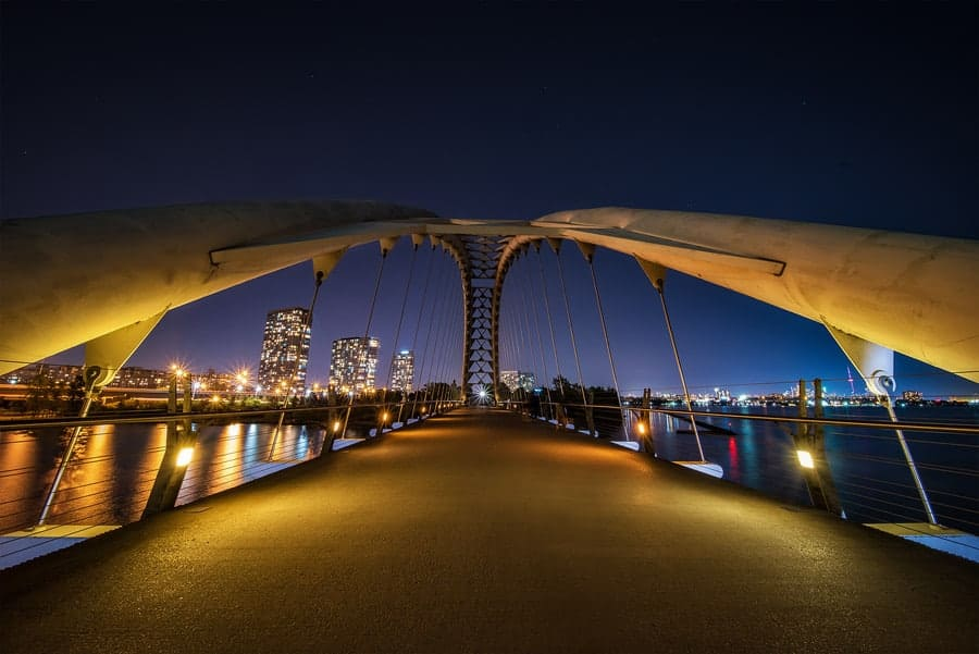 The Humber Bay Arch Bridge in Toronto at night, photographed by Tracy Munson, using the Laowa 12 mm Wide-Angle Zero D lens.