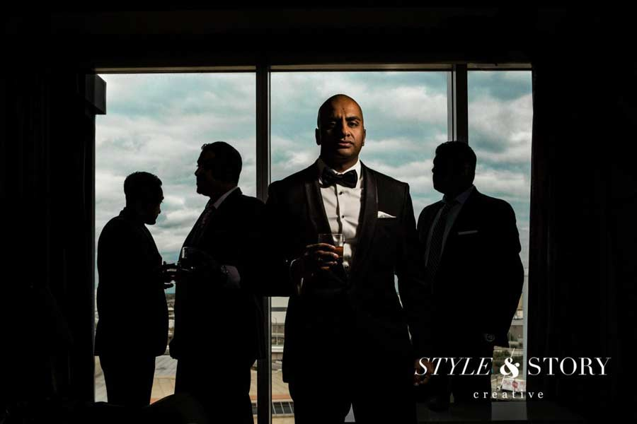 Grooms picture with groomsmen silhouetted