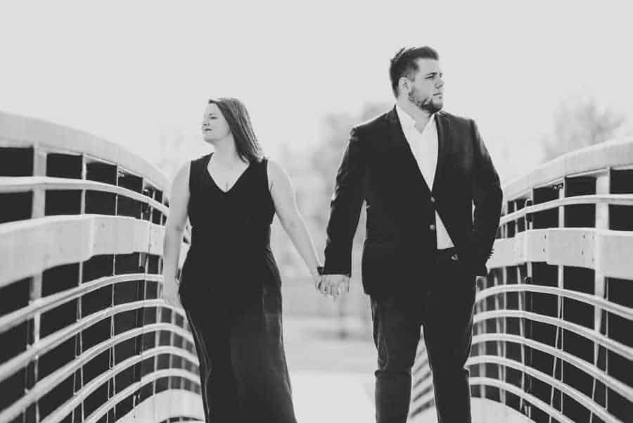 couple posing on a bridge