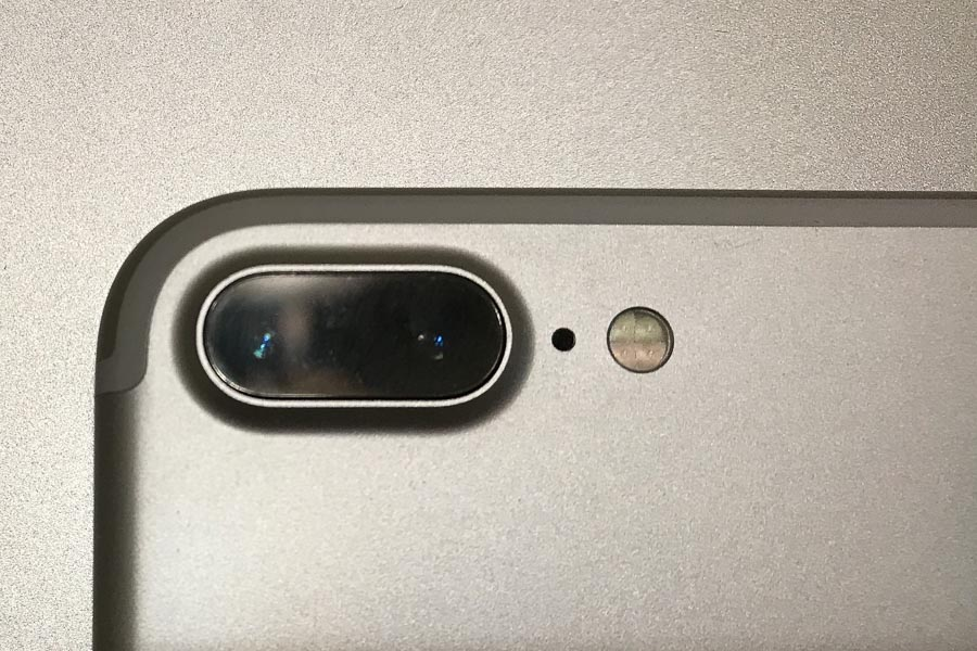 iPhone camera (7+, 8+, Xs and Xs Max) have two forward-facing cameras, one with a wide angle and the other with a telephoto lens.